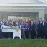 Chamber Ambassadors gather to celebrate the grand opening of the First Florida Bank on Harrison Ave.