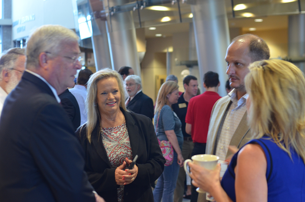 Chamber Members network together during First Friday.