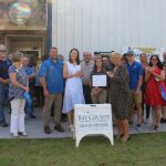 Chamber ambassadors gather with the staff at Brian McKenzie Roofing to celebrate their grand opening.