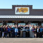 Chamber ambassadors gather with the staff at Cracker Barrel for a ribbon cutting celebration before the grand opening.