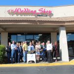 Chamber Ambassadors gather to celebrate the grand opening of the Wedding Shop by uniting happiness.