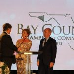 Claire Sherman, 2017 Chairman of the Board, awards Member of the Year Award to Waylon Thompson and Doug Smith.