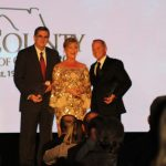 Claire Sherman, 2017 Chairman of the Board, awards Chairman's Award to Glenn McDonald and Tom Neubauer.
