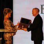 Claire Sherman, 2017 Chairman of the Board, presents Richard Dodd with Lauren Merriam Memorial Award.