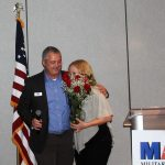 Robert Carroll presents roses to his wife to thank her for her support.