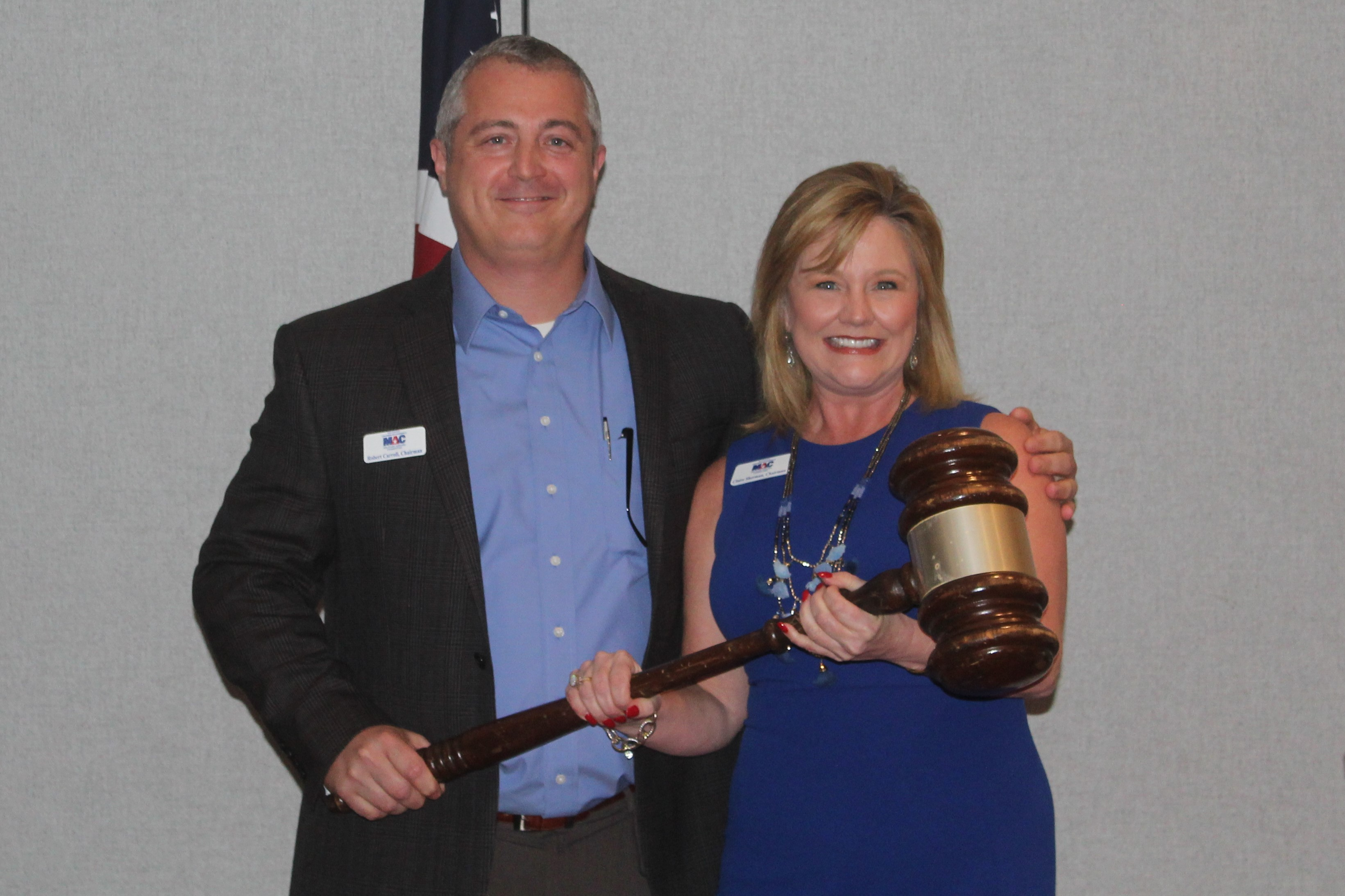 2017 MAC Chairman, Robert Carroll, passes the gavel to 2018 MAC Chairman, Claire Sherman at 2018 Passing of the Gavel event.