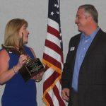 2018 MAC Chairman, Claire Sherman, presents 2017 MAC Chairman, Robert Carroll, the Distinguished Service Award.