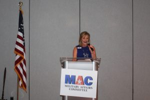 Claire Sherman, 2018 MAC Chairman, at podum