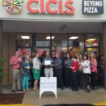 Chamber ambassadors gather to celebrate the grand opening of Cici's.