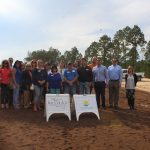 Chamber Ambassadors gather to celebrate the Seagrass Village PCB ground breaking.