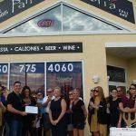 Chamber ambassadors gather to celebrate the grand opening of Panama Pizzeria.