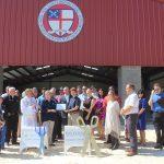 Chamber ambassadors gather to celebrate the grand opening of Holy Nativity Pavilion.