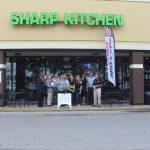 Chamber Ambassadors gather to celebrate the grand opening of Sharp Kitchen.