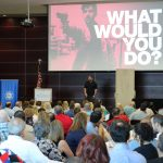 Chamber members participate in First Friday, sponsored by Hancock Whitney, where David Thomasee shared tips on how to keep people safe during an active shooter situation.