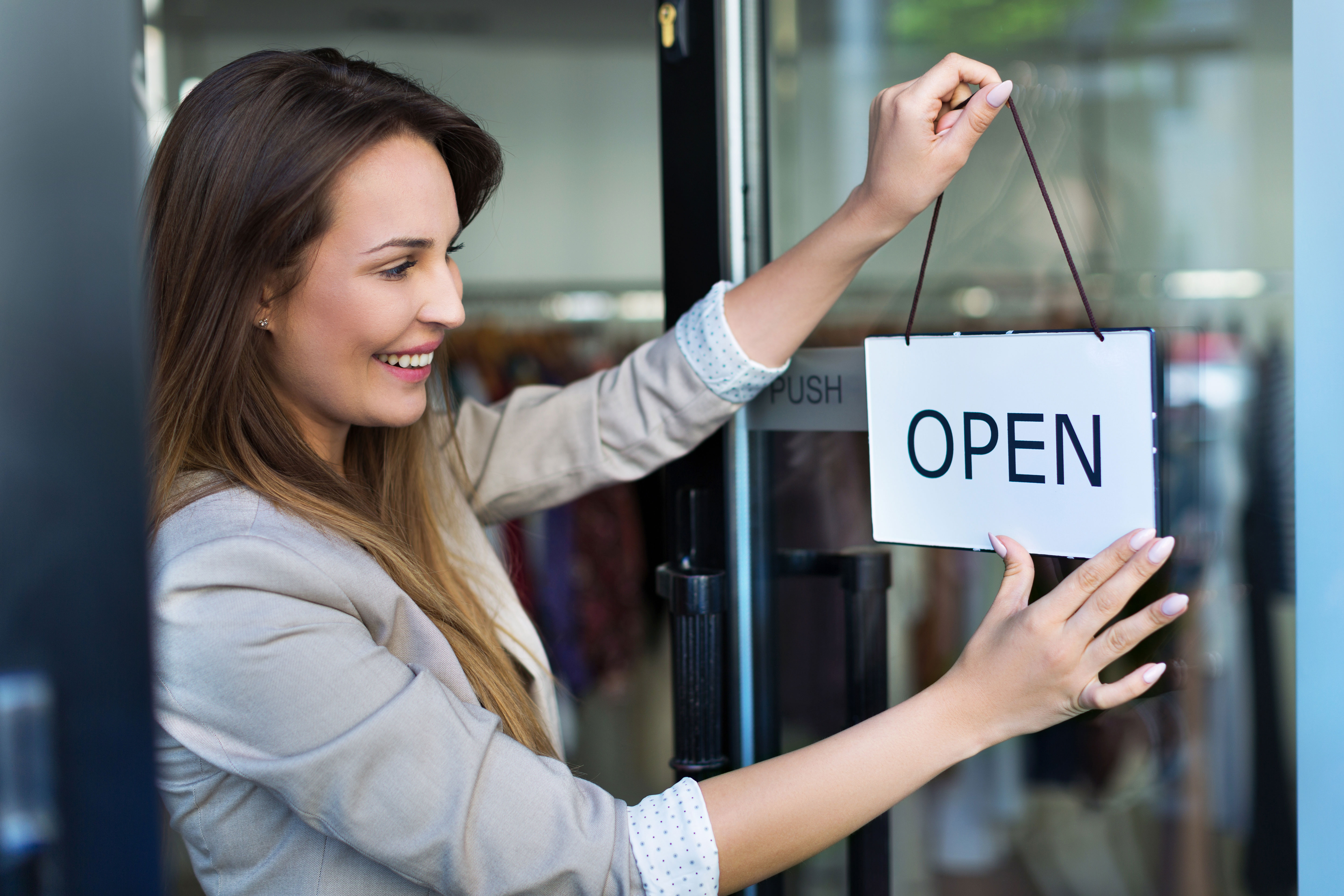 female opens store for business