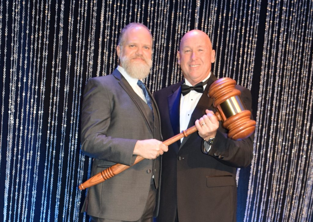 """2019 Chairman of the Board """"passes the gavel"""" to 2020 Chairman of the Board, Andrew Rowell."""